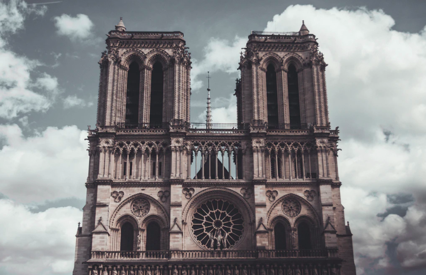 Cathedral Notre Dame de Paris surrounded by clouds