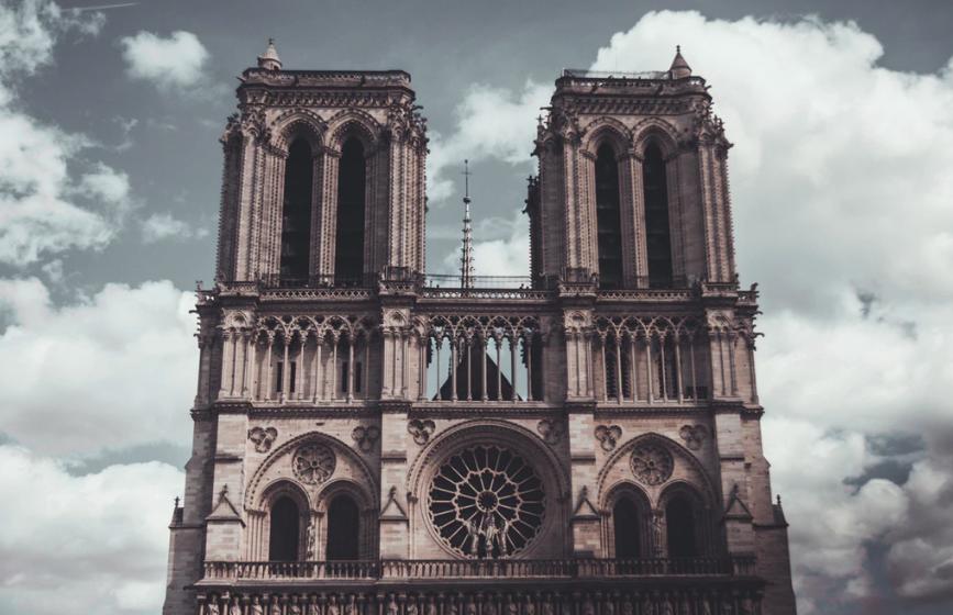 Cathedral Notre Dame de Paris surrounded by clouds
