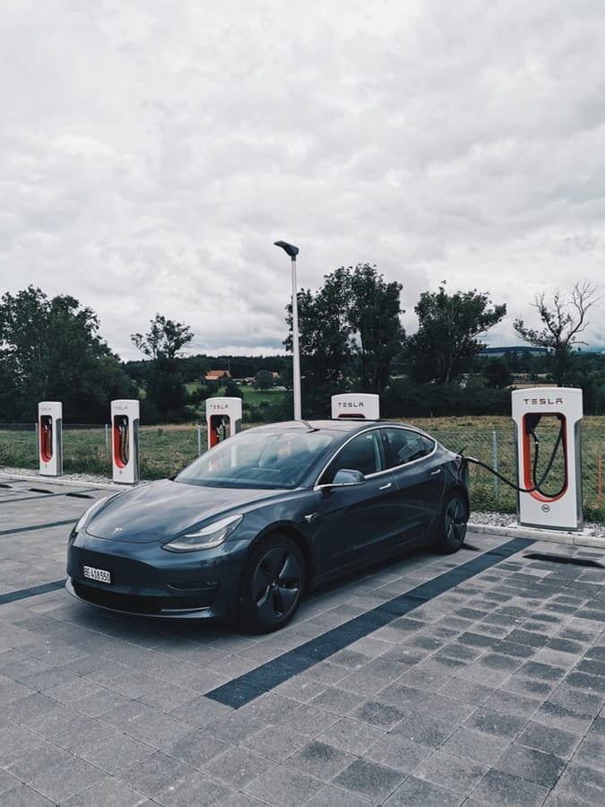 Tesla car carrying with electricity on a parking